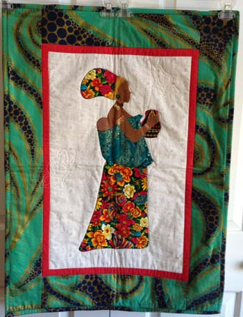 woman-with-child-quilt-1425923551-jpg