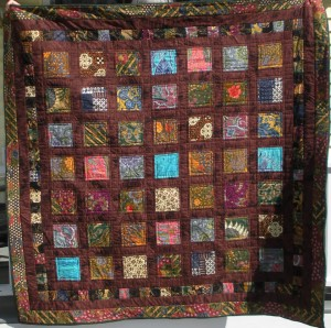 From M Kotch. Made my son a throw using some batiks from your Indonesian bundle, along with some old family batik clothes!